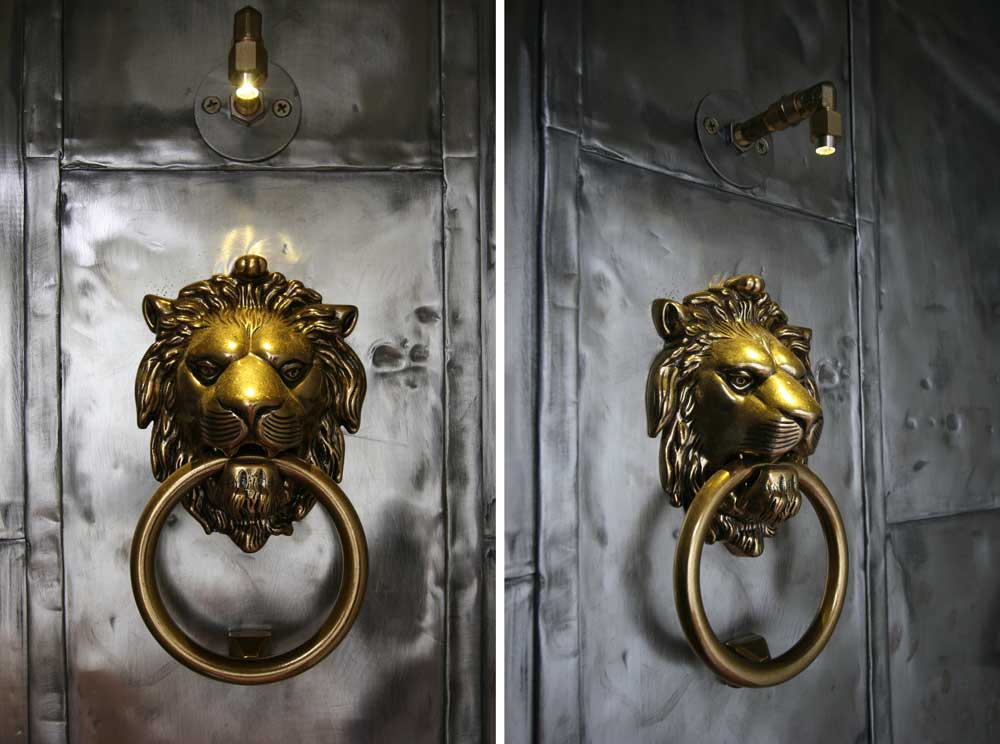 steel encased door with LED illuminated brass lion's head knocker
