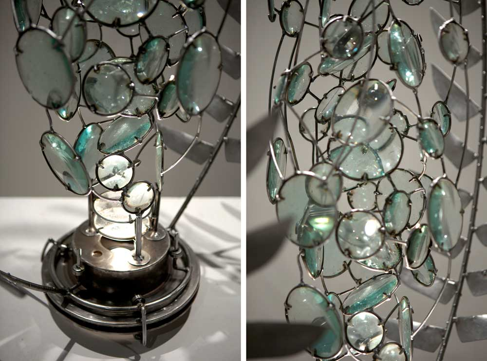 swirling lenses framed by steel laurel branches